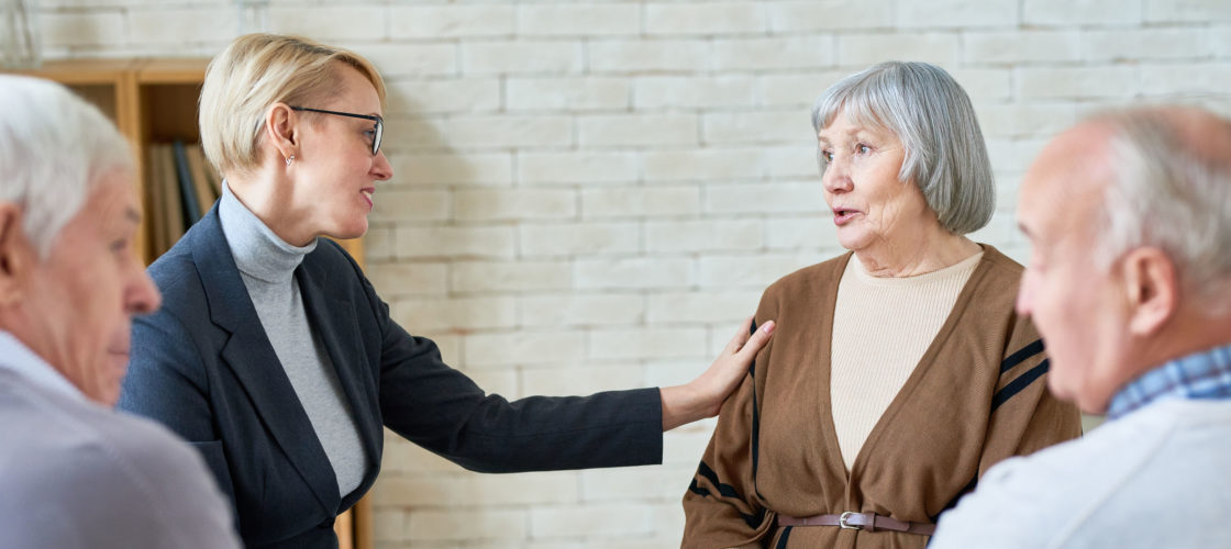 older couple at support group with others