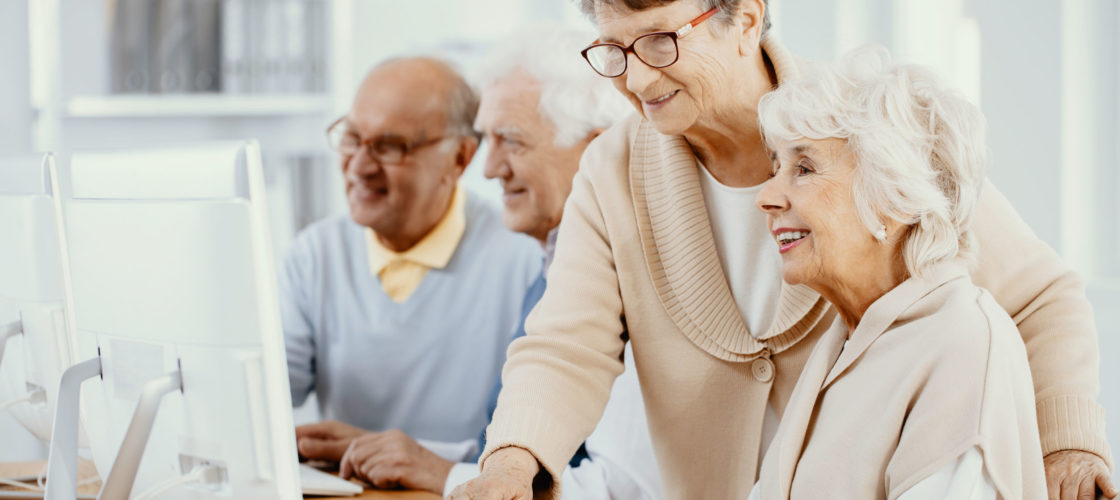 instructor helping older adults learn computer skills