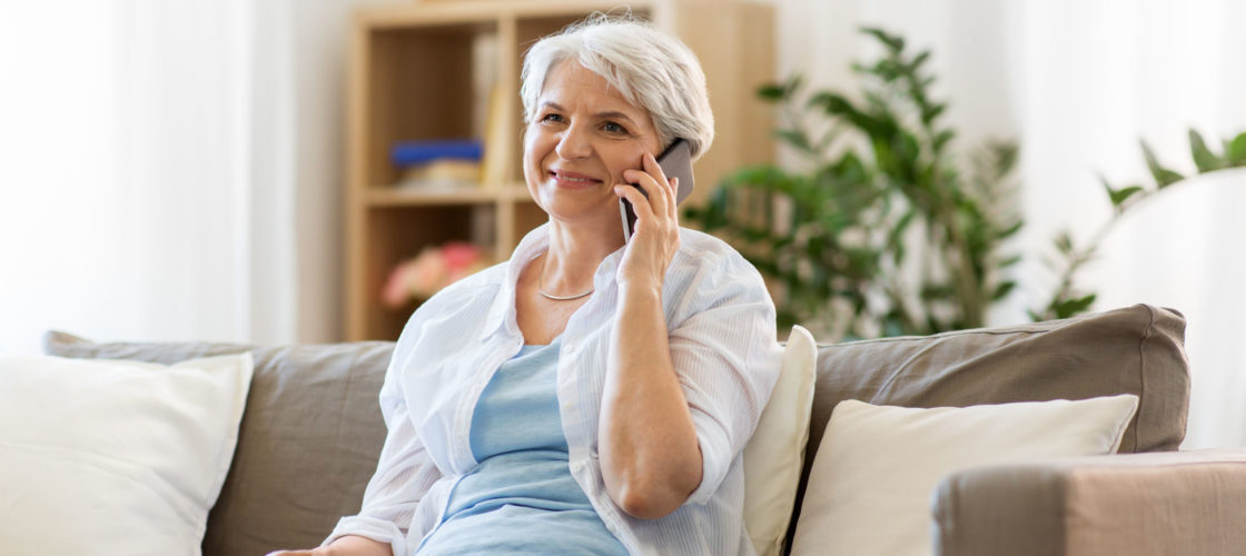 Older woman on phone at home