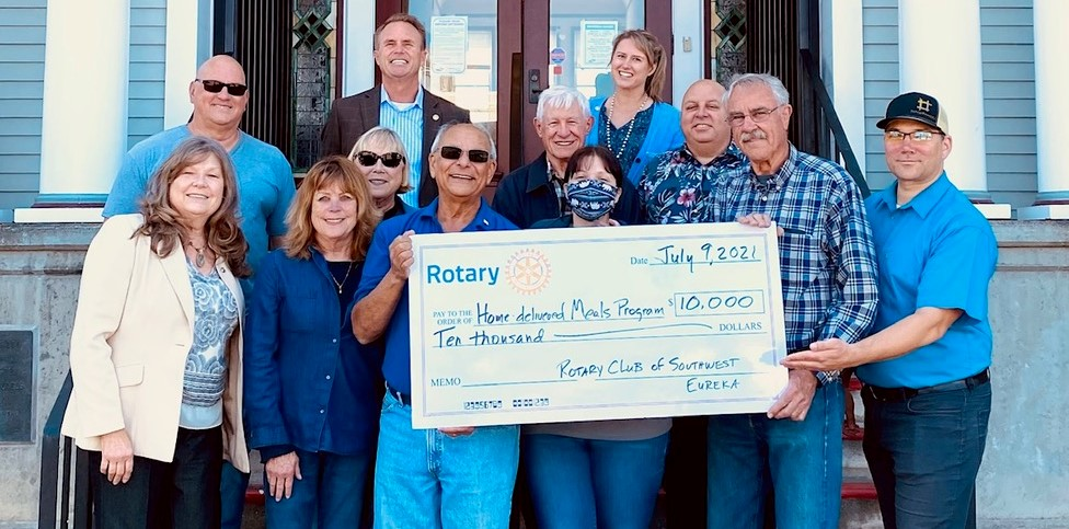 SW Rotary members present check to HSRC